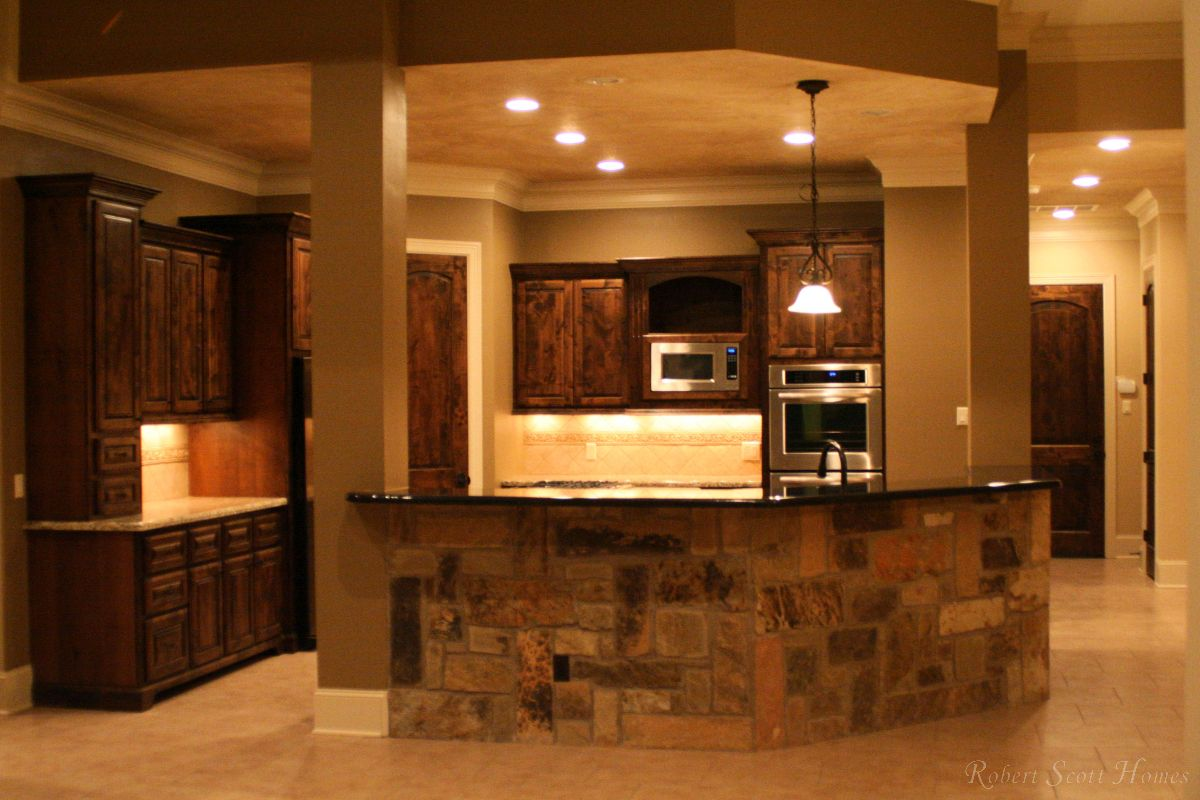 Custom Kitchen Renovation with Stone Bar Wall