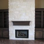 Stone Fireplace With Dark Wood Book Cases